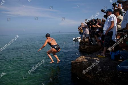 Chloe McCardel Australian swimmer Chloe McCardel jumps into the water at Hemingway Marina to start her swim to Florida from Havana, Cuba, . McCardel, 29, is bidding to become the first person to make the Straits of Florida crossing without the protection of a shark cage. American Diana Nyad and Australian Penny Palfrey have attempted the crossing four times between them since 2011, but each time threw in the towel part way through due to injury, jellyfish stings or strong currents. Australian Susie Maroney did it in 1997, but with a shark cage