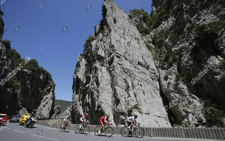 The breakaway group with Jean Marc Marino of France, Johnny Hoogerland of The Netherlands, Rudy Molard of France, and Christophe Riblon of France, from left to right, climbs towards Pailheres pass during the eight stage of the Tour de France cycling race over 195 kilometers (122 miles) with start in Castres and finish in Ax 3 Domaines, Pyrenees region, France