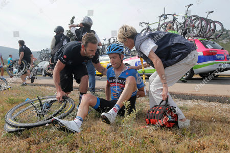 Stock Photo of Christian Vandevelde of the U.S. grimaces after crashing in the last kilometers of the fifth stage of the Tour de France cycling race over 228.5 kilometers (142.8 miles) with start in Cagnes-sur-Mer and finish in Marseille, southern France