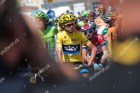 Stock Photo of Christopher Froome of Britain, wearing the overall leader's yellow jersey, and Johnny Hoogerland of The Netherlands, center in red, white and blue jersey, wait for the start of the tenth stage of the Tour de France cycling race over 197 kilometers (123.1 miles) with start in in Saint-Gildas-des-Bois and finish in Saint-Malo, Brittany region, western France