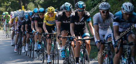 Stock Picture of Christopher Froome of Britain, wearing the overall leader's yellow jersey, and Edvald Boasson Hagen of Norway, left of Froome, ride in the pack during the tenth stage of the Tour de France cycling race over 197 kilometers (123.1 miles) with start in in Saint-Gildas-des-Bois and finish in Saint-Malo, Brittany region, western France