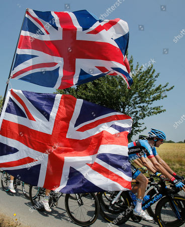 British flags fly as David Millar of Britain, right, passes during the twelfth stage of the Tour de France cycling race over 218 kilometers (136.2 miles) with start in in Fougeres and finish in Tours, western France