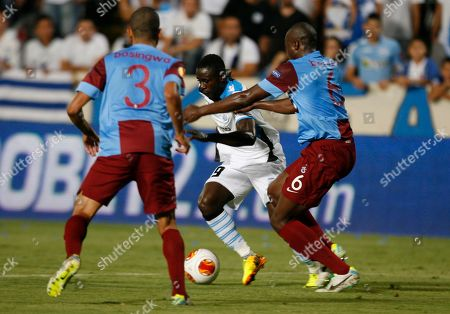 Guile Gneki Abraham, Jose Bosingwa,Sol Bamba Guile Gneki Abraham of Apollon Limassol FC fights for the ball with Jose Bosingwa, left, and Sol Bamba, right, of Trabzonspor, during their Europa League group J soccer match at GSP stadium in Nicosia, Cyprus