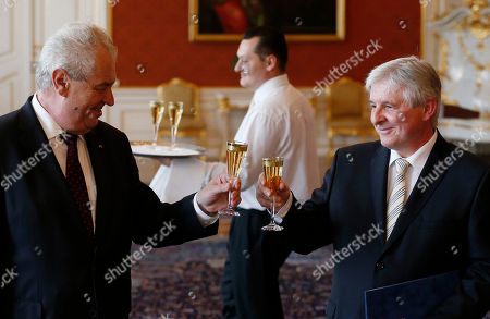 Milos Zeman, Jiri Rusnok Czech Republic's President Milos Zeman, left, toasts with champagne with newly appointed Prime Minister Jiri Rusnok, right, at the Prague Castle in Prague, Czech Republic, . Acting against the will of major parliamentary political parties in the Czech Republic, President Zeman appointed on Tuesday his economic adviser as the country's new prime minister to form a government of experts, replacing the center-right cabinet of Petr Necas who resigned last week amid a spy and bribery scandal