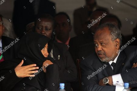 """Ismail Omar Guelleh the President of Djibouti, right, chats with the widow of late Meles Zenawi, Azeb Mesfin, during the the first year anniversary ceremonyof the death of long-time ruler Meles Zenawi in Addis Ababa, Ethiopia, . The ceremony was attended by regional leaders such presidents of Somalia and Sudan. Meles was praised as 'Africa's voice"""". His successor Prime Minister Prime Minister Hailemariam Desalegn praised Meles as a """"champion of the poor"""