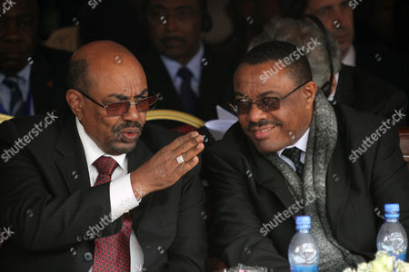 """Ethiopian prime minister Hailemariam Dessalegni and Sudan's President Omar al-Bashir chat during the the first year anniversary ceremonyof the death of long-time ruler Meles Zenawi in Addis Ababa, Ethiopia, . The ceremony attended by regional leaders including presidents of Somalia and Sudan, Meles was praised as """"Africa's voice."""" His successor Prime Minister Prime Minister Hailemariam Desalegn praised Meles as a """"champion of the poor"""
