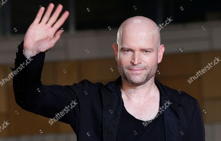 "Marc Forster Director Marc Forster waves for photographers upon arrival for the Japan premiere of his film ""World War Z"" in Tokyo. An old screenplay, ""The Downslope,"" by Stanley Kubrick is being developed as a trilogy by Forster. Producers Lauren Selig, Barry Levin and Renee Wolfe said, their plans have the support of the Kubrick family"