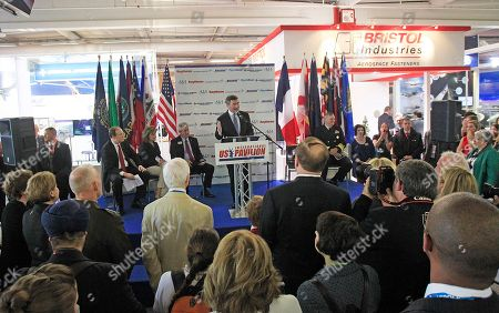 U.S ambassador to France Charles H. Rivkin, center, delivers his speech at the inauguration of the U.S. pavilion, on the first day of the Paris Air Show at Le Bourget airport, north of Paris