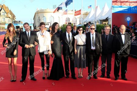 Vincent Lindon, Famke Janssen, Rebecca Zlotowski, Lou Doillon, Xavier Giannoli, Helene Fillieres, Jean Echenoz, Bruno Nuytten, Pierre Lescure From left, jury members Lou Doillon, Xavier Giannoli, Helene Fillieres, Famke Janssen, Jury President Vincent Lindon, Rebecca Zlotowski, Jean Echenoz, Bruno Nuytten and Pierre Lescure arrive for the opening ceremony of the 39th American Film Festival, Friday, Aug. 30, 2013, in Deauville, Normandy, western France