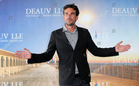 Director Alexandre Moors poses during a photocall at the 39th American Film Festival, Saturday, Aug. 31, 2013, in Deauville, Normandy, western France