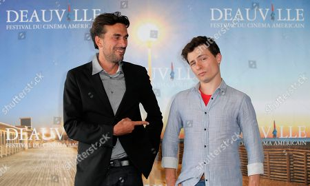 Director Alexandre Moors, left, and writer Ronnie Porto pose during a photocall at the 39th American Film Festival, Saturday, Aug. 31, 2013, in Deauville, Normandy, western France
