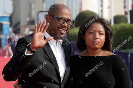 "Stock Photo of Forest Whitaker, Sonnet Whitaker Actor Forest Whitaker, left, and his daughter Sonnet arrive for the screening of the film ""The Butler"" at the 39th American Film Festival, in Deauville, Normandy, western France"