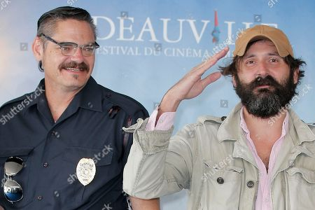 "Quentin Dupieux, Mark Burnham Director Quentin Dupieux, right, and actor Mark Burnham pose during a photocall for their film ""Wrong Cops"" at the 39th American Film Festival, Sunday, Sept. 1, 2013, in Deauville, Normandy, western France"