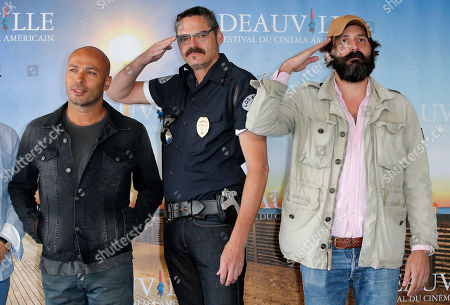 "Director Quentin Dupieux, right, with actors, Mark Burnham,center and Eric Judor pose during a photocall for their film ""Wrong Cops"" at the 39th American Film Festival, Sunday, Sept. 1, 2013, in Deauville, Normandy, western France"