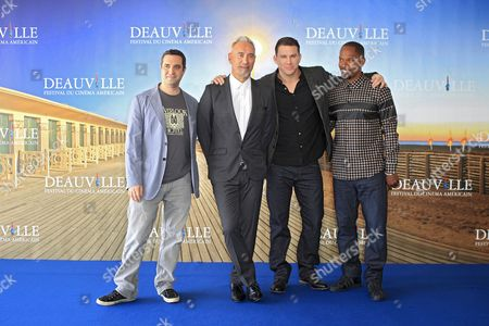 """Stock Photo of Left to right, Producer Brad Fisher, Director Roland Emmerich, actors Channing Tatum and Jamie Foxx pose during a photocall for their film """"White House Down"""" at the 39th American Film Festival, Sunday, Sept. 1, 2013, in Deauville, Normandy, western France"""