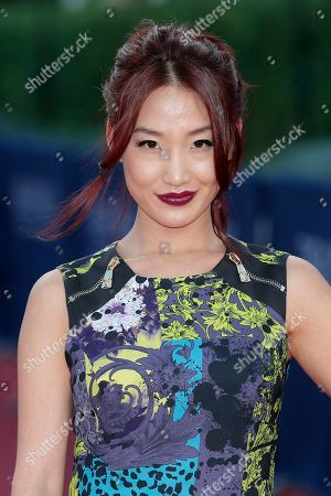 """Alice Kim Alice Kim, the wife of actor Nicolas Cage, arrives for the screening of the film """"Joe"""" at the 39th American Film Festival, in Deauville, Normandy, western France"""