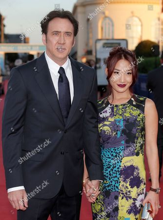 """Alice Kim, Nicolas Cage Nicolas Cage and his wife Alice Kim arrive for the screening of the film """"Joe"""" at the 39th American Film Festival, in Deauville, Normandy, western France"""