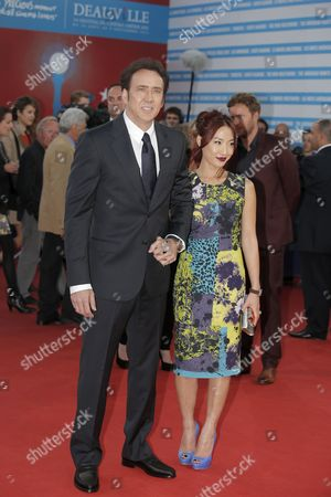 """Alice Kim, Nicolas Cage Nicolas Cage, left, and his wife Alice Kim arrive for the screening of the film """"Joe"""" at the 39th American Film Festival, in Deauville, Normandy, western France"""