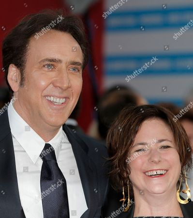 """Nicolas cage, Lisa Muskat Nicolas Cage, left, and producer Lisa Muskat arrive for the screening of the film """"Joe"""" at the 39th American Film Festival, in Deauville, Normandy, western France"""