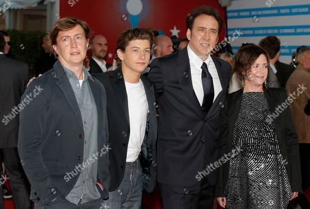 """Stock Photo of Left to right, director David Gordon Green, actors Tye Sheridan, Nicolas Cage and producer Lisa Muskat arrive for the screening of their film """"Joe"""" at the 39th American Film Festival, in Deauville, Normandy, western France"""