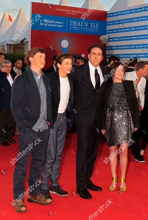 """Left to right, director David Gordon Green, actors Tye Sheridan, Nicolas Cage and producer Lisa Muskat arrive for the screening of their film """"Joe"""" at the 39th American Film Festival, in Deauville, Normandy, western France"""