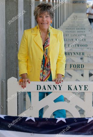 The daughter of American actor Danny Kaye, Dena Kaye attends the unveiling of a beach hut named after her father, during a ceremony at the Deauville promenade Wednesday, Sept. 4, 2013, at the 39th American Film Festival, in Deauville, Normandy, western France. The American actor, singer, dancer, and comedian, Danny Kaye, died in 1987, and was honored in Deauville Wednesday