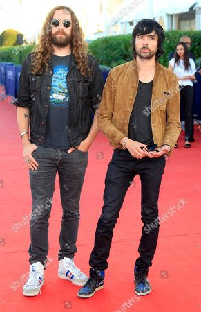 French musicians Xavier de Rosnay, right, and Gaspard Auge of the group Justice arrive at the 39th American Film Festival, in Deauville, Normandy, western France
