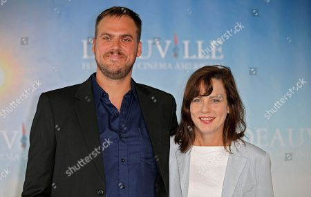 """Director Jim Mickle and producer Linda Moran pose during a photocall for their film """"We are what we are"""" at the 39th American Film Festival, Friday, Sept. 6, 2013, in Deauville, Normandy, western France"""