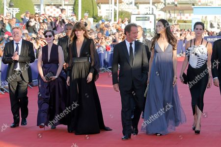 Jean Echenoz, Rebecca Zlotowski, Lou Doillon, Vincent Lindon, Famke Janssen,Helene Fillieres Jury members, from left, author Jean Echenoz, director Rebecca Zlotowski, actress and singer Lou Doillon, jury president actor Vincent Lindon, actresses Famke Janssen and Helene Fillieres arrive for the awards ceremony at the 39th American Film Festival, in Deauville, Normandy, western France