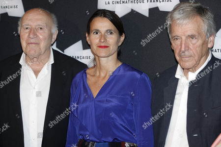 French actor Michel Piccoli, left, French Culture Minister Aurelie Filippetti, center, and French director Costa Gavras, right, pose for photographers, during a retrospective of Piccoli's career, in Paris