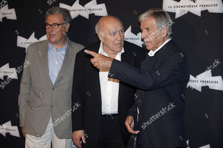 French actor Michel Piccoli, center, French director Costa Gavras, right, and General Director of the French Cinematheque Serge Toubiana, left, pose for photographers, during a retrospective of Piccoli's career, in Paris