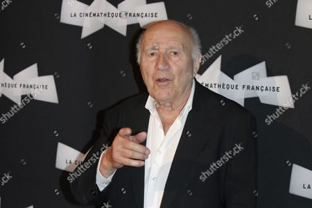 French actor Michel Piccoli gestures as he poses for photographers, during a retrospective of his career, in Paris