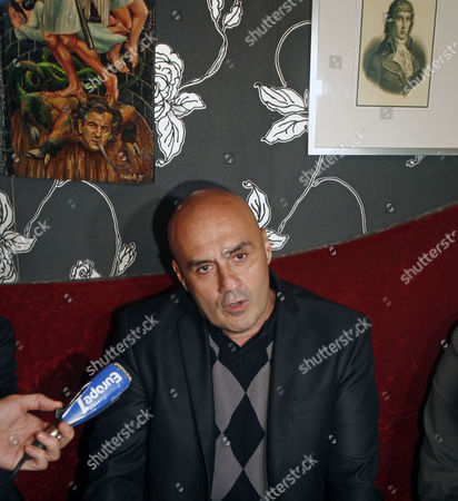 Stock Image of Serge Ayoub, leader of the French far-right Jeunesses Nationalistes Revolutionnaires, Revolutionary Nationalist Youth, movement addresses reporters during a press conference in Paris . Ayoub announced he had dissolved his movement that the government wanted to ban following the death of a student in an altercation two weeks ago