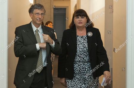 Microsoft founder and philanthropist Bill Gates, left, and European Commissioner for Research and Innovation Maire Geoghegan-Quinn arrives for a signing ceremony on a medical agreement for research support of the Global Fund to fight Tuberculosis and Malaria at the conclusion of their meeting, in Paris