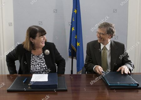 Microsoft founder and philanthropist Bill Gates, right, and European Commissioner for Research and Innovation Maire Geoghegan-Quinn smile together during a signing ceremony for a medical agreement on research support of the Global Fund to fight Tuberculosis and Malaria at the conclusion of their meeting, in Paris