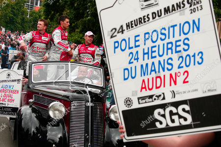 Loic Duval, Tom Kristensen, Allan McNish Audi R18 E-TRON Quattro No2 team drivers' Loic Duval of france, center, Tom Kristensen of Denmark, right, and Allan McNish of Scotland, left, are seen during a parade on the eve of the 90th 24-hour Le Mans endurance race, in Le Mans, western France, . The race will begin on Saturday, June 22