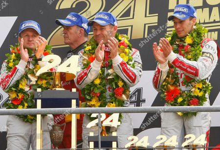 Tom Kristensen, Wolfgang Ullrich, Loic Duval, Allan McNish Audi Motorsports chief Dr. Wolfgang Ullrich, second left, with drivers, Tom Kristensen of Denmark, second right, Loic Duval of France, right, and Allan McNish of Scotland jubilate on the podium after winning the 90th 24-hour Le Mans endurance race, in Le Mans, western France