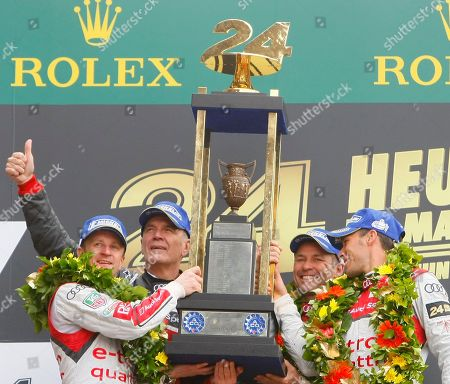 Tom Kristensen, Wolfgang Ullrich, Loic Duval, Allan McNish Audi Motorsports chief Dr. Wolfgang Ullrich, second left, with drivers, Tom Kristensen of Denmark, second right, Loic Duval of France, right, and Allan McNish of Scotland, left, celebrate with the trophy on the podium after they won the 90th 24-hour Le Mans endurance race, in Le Mans, western France