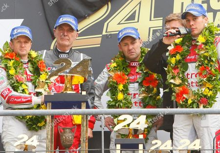 Stock Picture of Tom Kristensen, Wolfgang Ullrich, Loic Duval, Allan McNish Audi Motorsports chief Dr. Wolfgang Ullrich, second left, with drivers, Tom Kristensen of Denmark, center, Loic Duval of France, right, and Allan McNish of Scotland, left, are seen on the podium after winning the 90th 24-hour Le Mans endurance race, in Le Mans, western France
