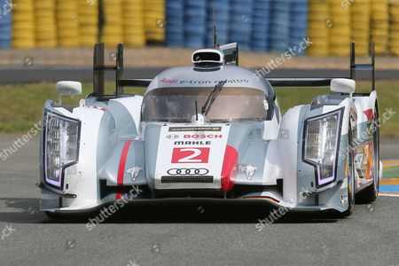 The Audi R18 E-Tron No2 driven by Tom Kristenssen of Denmark, Loic Duval of France and Allan McNish of Scotland is seen in action during the free practice session of the 90th 24-hour Le Mans endurance race, in Le Mans, western France, . The race will begin on Saturday, June 22