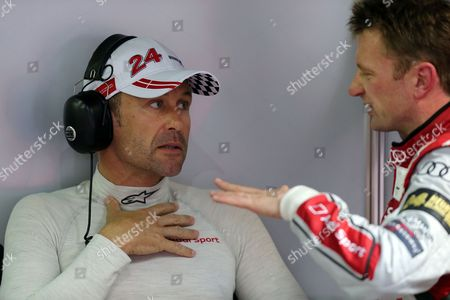 Tom Kristenssen, Allan McNish The Audi R18 E-Tron No2 driver Tom Kristenssen of Denmark has a talk with teammate Allan McNish of Scotland during the free practice session of the 90th 24-hour Le Mans endurance race, in Le Mans, western France, . The race will begin on Saturday, June 22