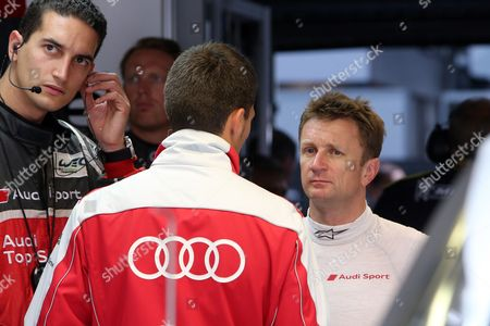 Allan McNish Driver Allan McNish, right, of Scotland has a talk with mechanics before the start of the free practice session of the 90th 24-hour Le Mans endurance race, in Le Mans, western France, . The race will begin on Saturday, June 22