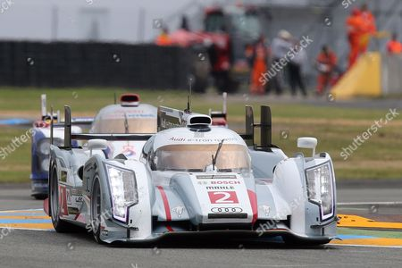The Audi R18 E-Tron No2 driven by Tom Kristenssen of Denmark, Loic Duval of France and Allan McNish of Scotland is seen in action ahead of the Toyota No7 during the free practice session of the 90th 24-hour Le Mans endurance race, in Le Mans, western France, . The race will begin on Saturday, June 22