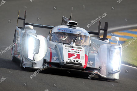 The Audi R18 E-Tron No2 driven by Tom Kristenssen of Denmark, Loic Duval of France and Allan McNish of Scotland is seen in action during the qualifying practice session of the 90th 24-hour Le Mans endurance race, in Le Mans, western France, . The race will begin on Saturday, June 22