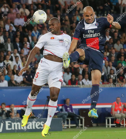 Rnald Zubar, Alex Ajaccio's Ronald Zubar, left, and Brazilian Alex, right, head the ball during a French League One soccer match Paris Saint-Germain against AC Ajaccio, in Paris