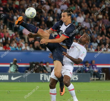 Zlatan Ibrahimovic, Ronald Zubar Paris Saint Germain's Swedish Zlatan Ibrahimovic, left, and Ajaccio's Ronald Zubar, right, challenge for the ball during a French League One soccer match Paris Saint-Germain against AC Ajaccio, in Paris