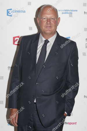 President of the French public media group France Televisions, Remy Pflimlin, poses during a photocall prior to the France Televisions new season press conference, in Paris