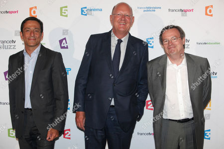President of the French public media group France Televisions, Remy Pflimlin, center, General Secretary and Executive Vice President, Resources at France Television, Martin Ajdari, left, and Deputy director of human resources and internal communications of France Televisions, Patrice Papet, right, pose during a photocall prior to the France Televisions new season press conference, in Paris