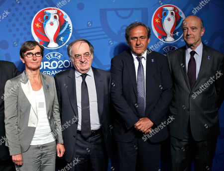 UEFA president Michel Platini, second right, Bordeaux mayor Alain Juppe, right, French soccer federation president Noel le Graet and French Sports minister Valerie Fourneyron pose for photographers as they unveil the logo of the EURO2016 soccer tournament, in Paris, . The Euro2016 will take place in France from June 10 to July 10 2016