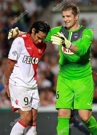 Cedric Carrasso, Radamel Falcao Bordeaux's goalkeeper Cedric Carrasso, right, and Monaco's Radamel Falcao react during the French League one soccer match in Bordeaux, southwestern France, Saturday, Aug.10, 2013